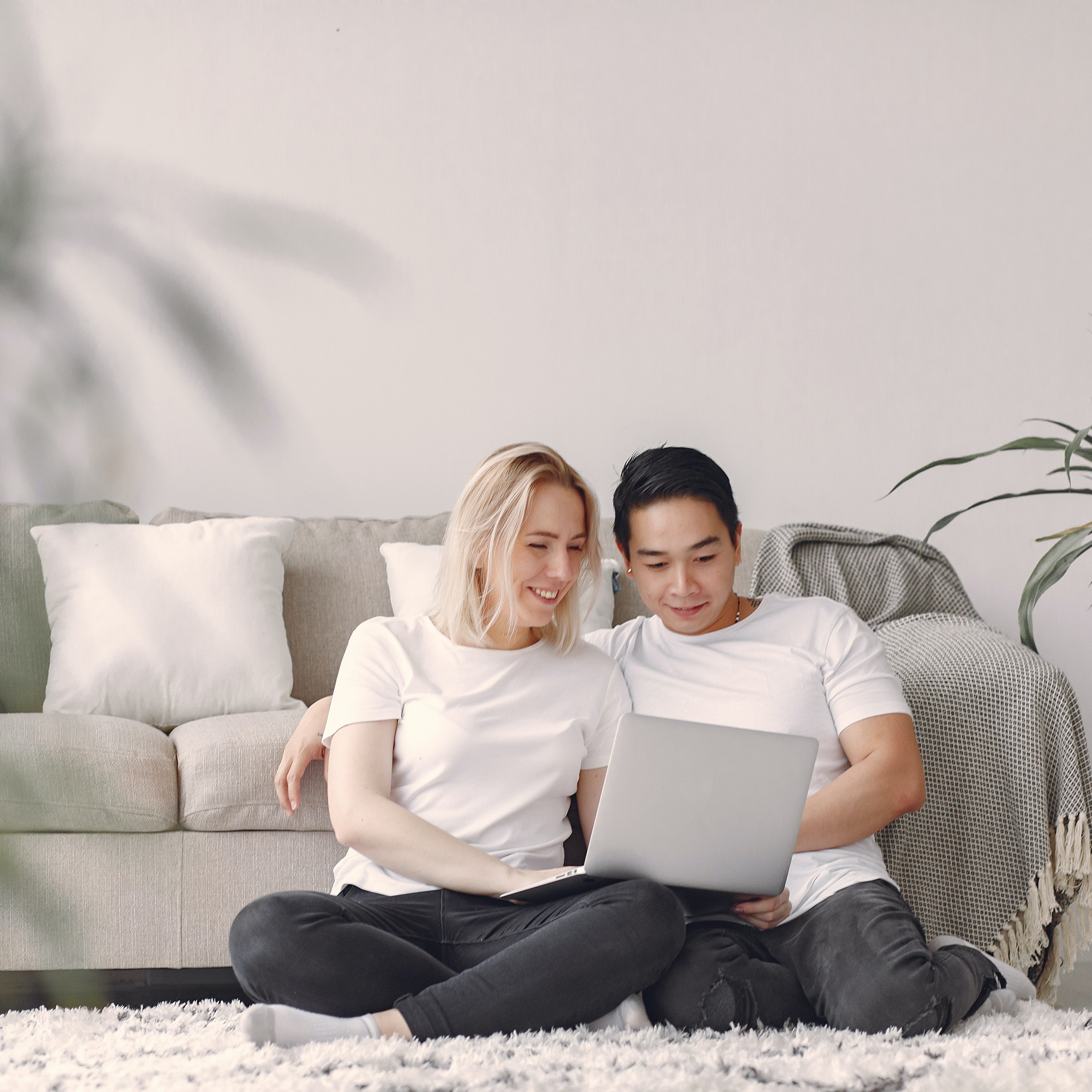 man-and-woman-in-white-crew-neck-t-shirt-sitting-on-a-rug-3912434